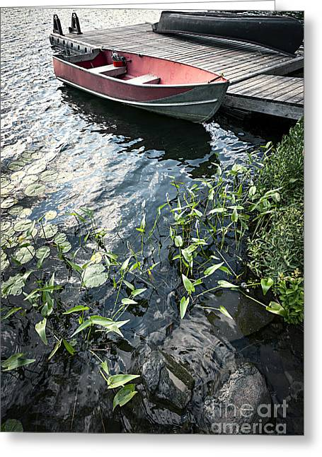 Green Canoe Greeting Cards - Boat at dock on lake Greeting Card by Elena Elisseeva