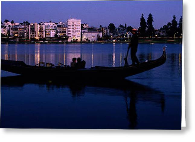 Downtown District Greeting Cards - Boat In A Lake With City Greeting Card by Panoramic Images