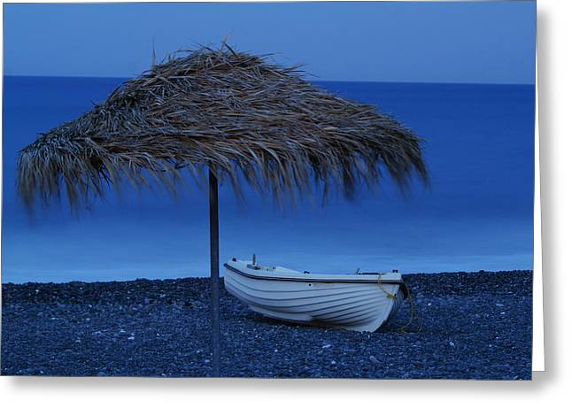 Beach At Night Greeting Cards - Boat on beach Greeting Card by Saul Moreno