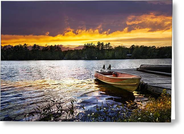 Wooden Boat Greeting Cards - Boat on lake at sunset Greeting Card by Elena Elisseeva