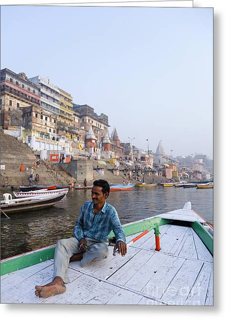 Boatman Greeting Cards - Boat on the River Ganges at Varanasi in India Greeting Card by Robert Preston