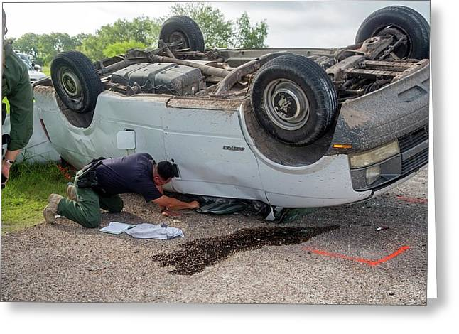 Border Patrol Officer Inspecting A Crash Greeting Card by Jim West