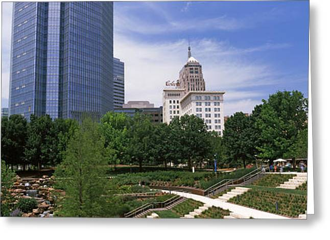 Botanical Greeting Cards - Botanical Garden With Skyscrapers Greeting Card by Panoramic Images