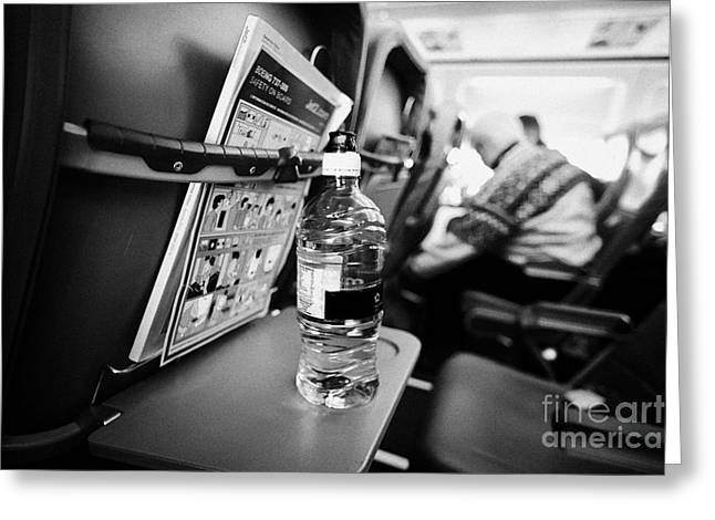 Cabin Interiors Photographs Greeting Cards - Bottle Of Water On Tray Table Interior Of Jet2 Aircraft Passenger Cabin In Flight Europe Greeting Card by Joe Fox