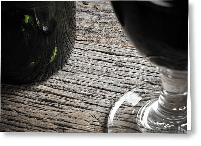Italian Wine Greeting Cards - Bottle of Wine and Glass of Red Wine on Rustic Table Greeting Card by Brandon Bourdages