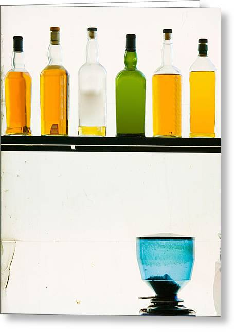 Wine Photography Greeting Cards - Bottles Displayed At The Bookworm Cafe Greeting Card by Panoramic Images