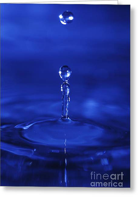 Surface Tension Greeting Cards - Bouncing droplets in blue Greeting Card by Paul Cowan