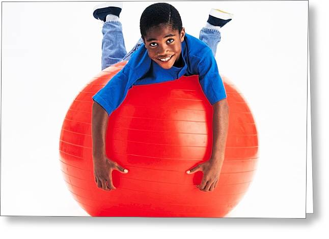 Boy Balancing On Exercise Ball Greeting Card by Ron Nickel