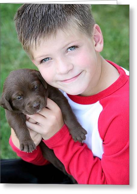 Boy Holding Puppy Greeting Card by Colleen Cahill