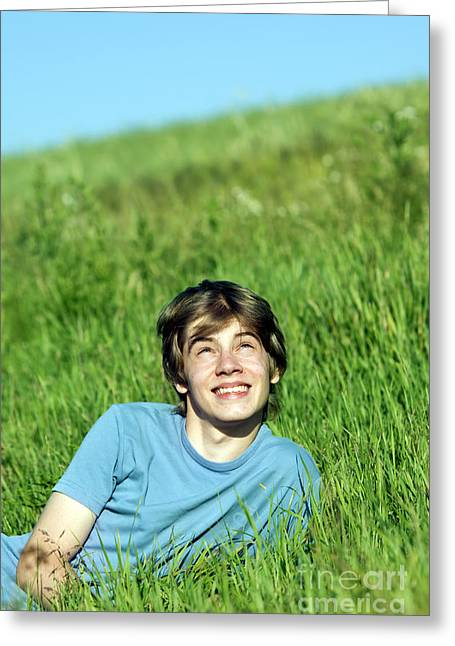 Teen Fashion Greeting Cards - Boy lying on the fresh green grass Greeting Card by Michal Bednarek