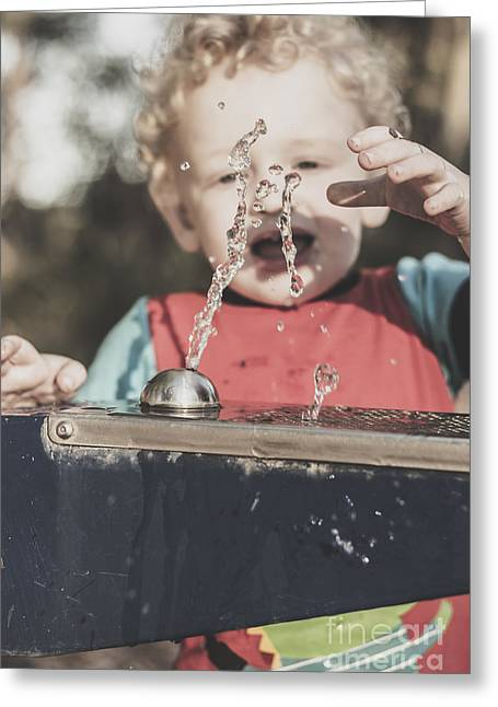 Real Experiences Greeting Cards - Boy mesmerised by the element of water in motion Greeting Card by Ryan Jorgensen