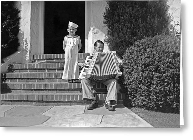 Boy Playing Accordian On Steps Greeting Card by Underwood Archives