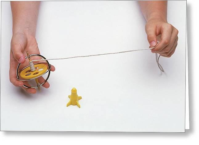 Boy's Hands Holding Gyroscope With String Greeting Card by Dorling Kindersley/uig