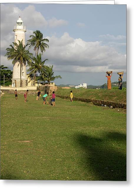 Boys Playing Cricket, Galle Lighthouse Greeting Card by Panoramic Images