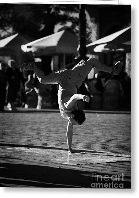 Polish City Greeting Cards - Breakdancing Male Young Street Entertainer Does A Hand Stand In The Rynek Glowny Main Square In The Old Town Krakow Greeting Card by Joe Fox