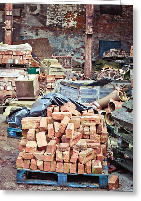 Discarded Greeting Cards - Bricks in scrap yard Greeting Card by Tom Gowanlock
