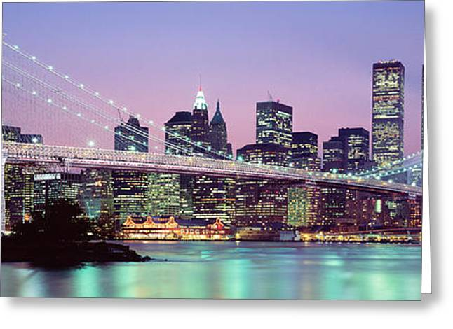 Famous Bridge Greeting Cards - Bridge Across A River Lit Up At Dusk Greeting Card by Panoramic Images