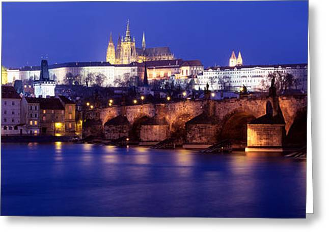 Hradcany Greeting Cards - Bridge Across A River Lit Up At Night Greeting Card by Panoramic Images