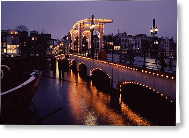 North Holland Greeting Cards - Bridge Lit Up At Night, Magere Brug Greeting Card by Panoramic Images