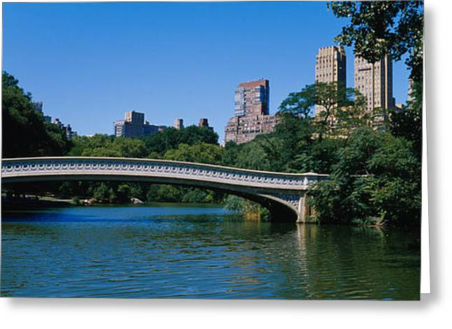 Bow Bridge Greeting Cards - Bridge Over A Lake, Bow Bridge Greeting Card by Panoramic Images
