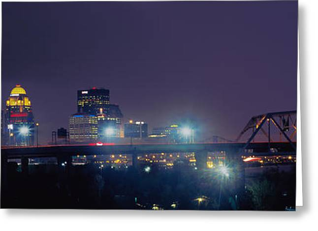 River Photography Greeting Cards - Bridge With Skyline Lit Up At Night Greeting Card by Panoramic Images