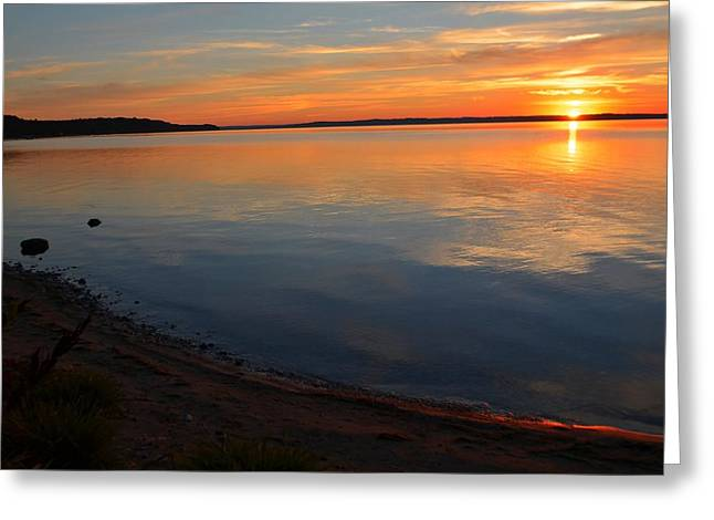 Elk Rapids Greeting Cards - Brilliant sunset over Grand Traverse Bay Greeting Card by Dave Zuker