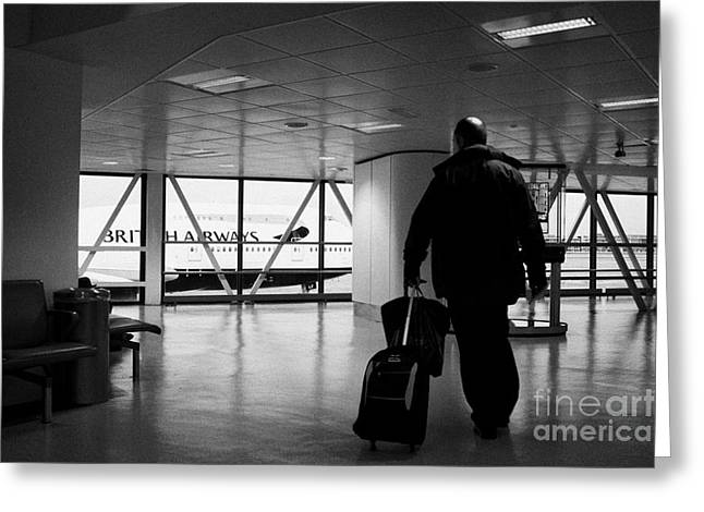 Airport Terminal Greeting Cards - British Airways 747 Jumbo Jet Passing Man With Rolling Travel Case In Terminal 1 Passenger Terminal  Greeting Card by Joe Fox