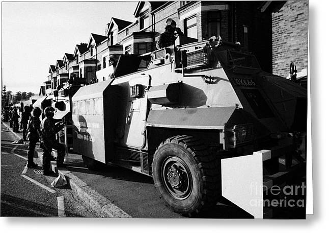 Terrorism Greeting Cards - British army armoured Saxon personnel carrier vehicle on crumlin road at ardoyne shops belfast 12th  Greeting Card by Joe Fox