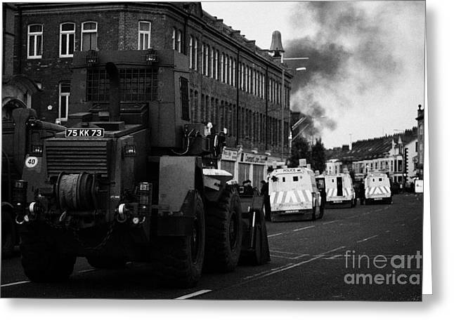 Protest Greeting Cards - British Army earth moving equipment parked on the Albertbridge road just short of loyalist rioters B Greeting Card by Joe Fox