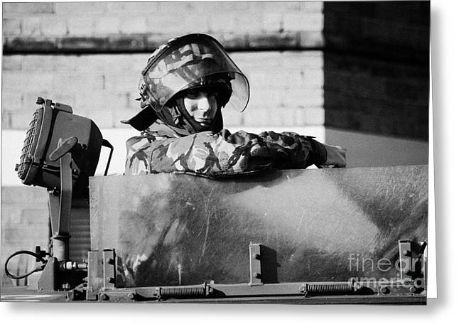 Terrorism Greeting Cards - British Army soldier in hatch of armoured land rover on crumlin road at ardoyne shops belfast 12th J Greeting Card by Joe Fox