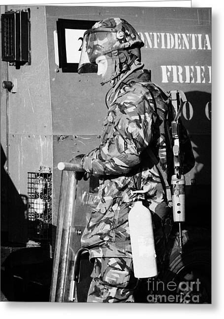 Terrorism Greeting Cards - British Army soldier in riot gear with fire extinguisher in front of land rover on crumlin road at a Greeting Card by Joe Fox
