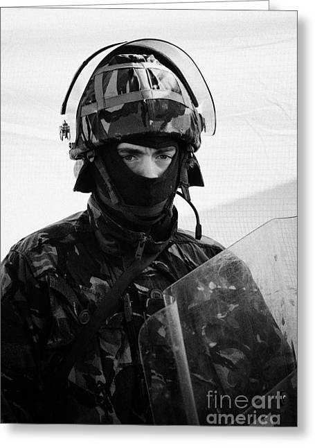 Terrorism Greeting Cards - British Army soldier in riot gear with helmet and shield on crumlin road at ardoyne shops belfast 12 Greeting Card by Joe Fox