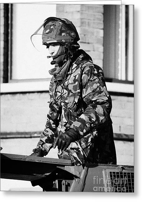 Terrorism Greeting Cards - British Army soldier in turret of Saxon Vehicle in front of houses on Crumlin road at ardoyne shops  Greeting Card by Joe Fox