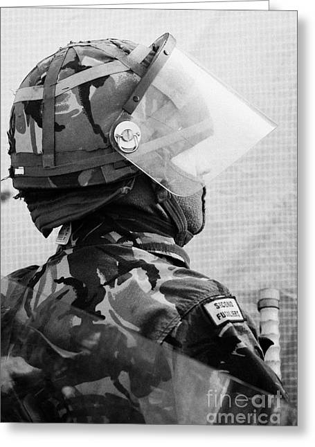 Terrorism Greeting Cards - British Army soldier with helmet riot gear on crumlin road at ardoyne shops belfast 12th July Greeting Card by Joe Fox