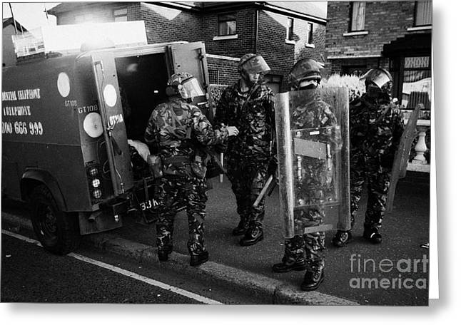 Terrorism Greeting Cards - British Army soldiers in riot gear pack up on crumlin road at ardoyne shops belfast 12th July Greeting Card by Joe Fox