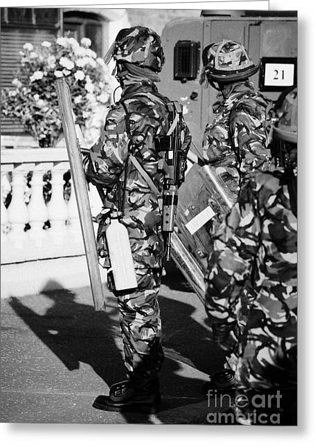 Terrorist Greeting Cards - British army soldiers in riot gear with fire extinguisher on crumlin road at ardoyne shops belfast 1 Greeting Card by Joe Fox