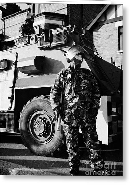 Terrorism Greeting Cards - British army soldiers in riot gear with Saxon armoured personnel carrier vehicle on crumlin road at  Greeting Card by Joe Fox