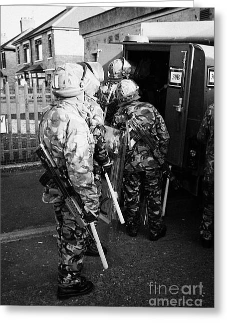 Terrorist Greeting Cards - British Army soldiers pack up riot gear on crumlin road at ardoyne shops belfast 12th July Greeting Card by Joe Fox