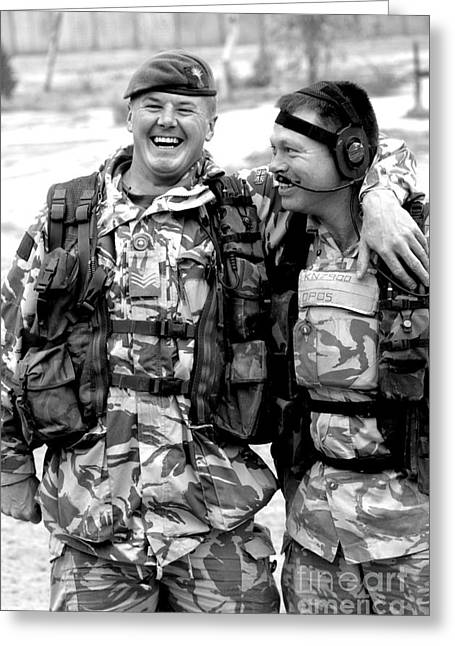 Arm Around Greeting Cards - British Soldier And Iraqi Police Greeting Card by Andrew Chittock