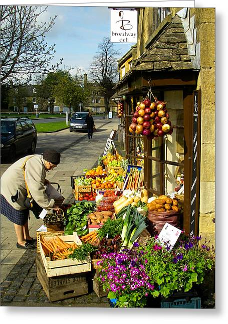 Geobob Greeting Cards - Broadway Deli and Fruit Stand on the Green Broadway Village Cotswold District England Greeting Card by Robert Ford
