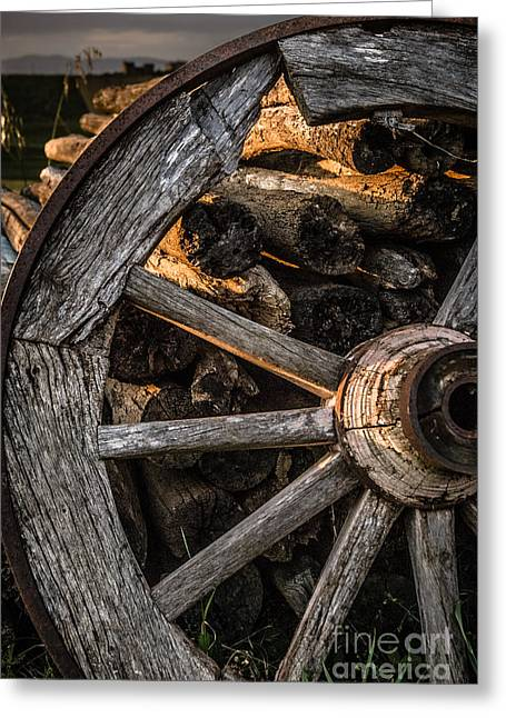 Italian Sunset Greeting Cards - Broken cart wheel with missing spoke and logs on a farm at Pacia Greeting Card by Peter Noyce