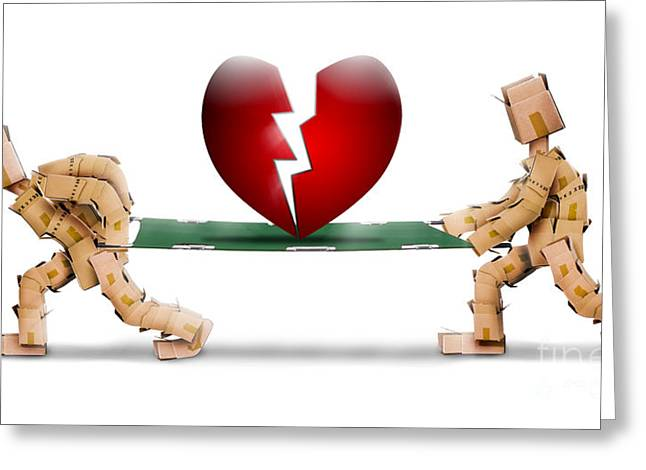 Cardboard Greeting Cards - Broken heart carried on a stretcher by box men Greeting Card by Simon Bratt Photography LRPS