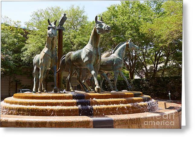 Greek Sculpture Greeting Cards - Bronze sculpture of four horses in front of Charleston Place Greeting Card by Louise Heusinkveld
