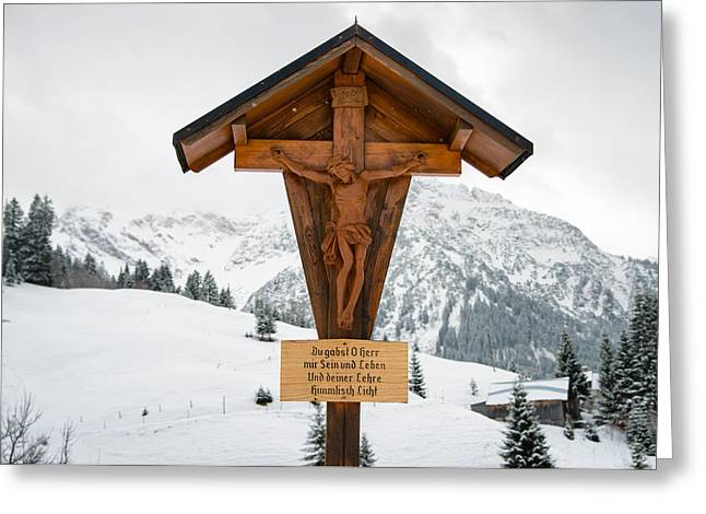 Wayside Cross Greeting Cards - Brown wayside crucifix in the mountains in winter with snow Greeting Card by Matthias Hauser