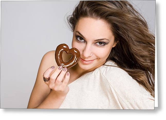 Gray Hair Greeting Cards - Brunette beauty with heart shaped chocolate. Greeting Card by Alstair Thane