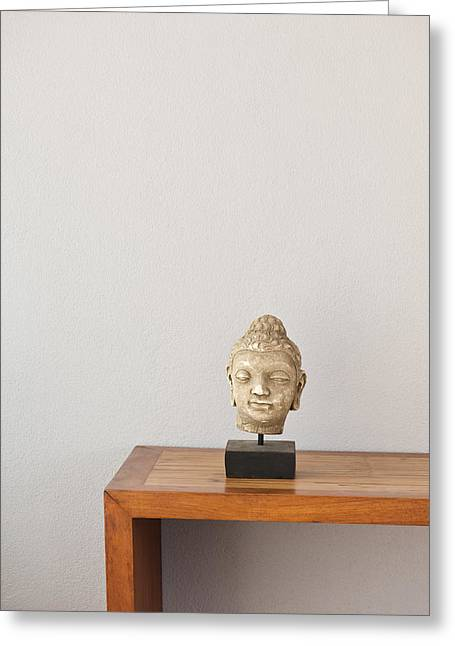 Sideboard Greeting Cards - Buddha head in front of a grey wall Greeting Card by Ulrich Schade