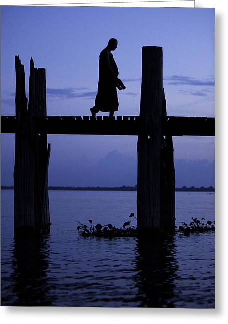 Buddhist Monks Greeting Cards - Buddhist monk walking over U Beins bridge at dusk Greeting Card by Ruben Vicente