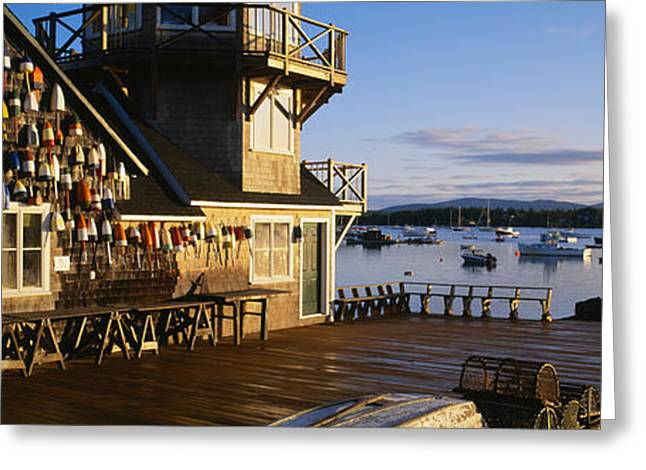 New England Village Scene Greeting Cards - Building At The Waterfront, Fishing Greeting Card by Panoramic Images