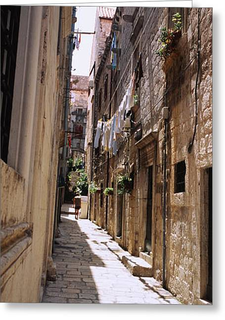 Residential Structure Greeting Cards - Buildings Along An Alley In Old City Greeting Card by Panoramic Images