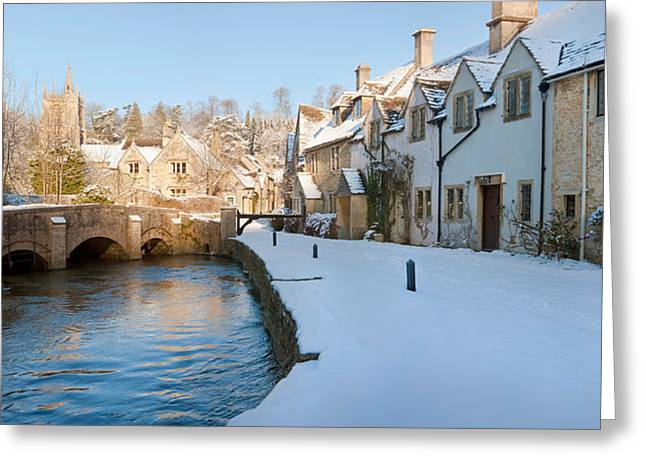 Cold Day Greeting Cards - Buildings Along Snow Covered Street Greeting Card by Panoramic Images
